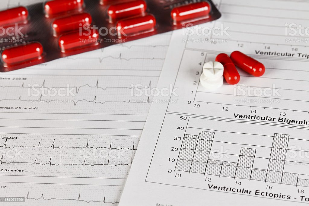 EKG chart with pills stock photo