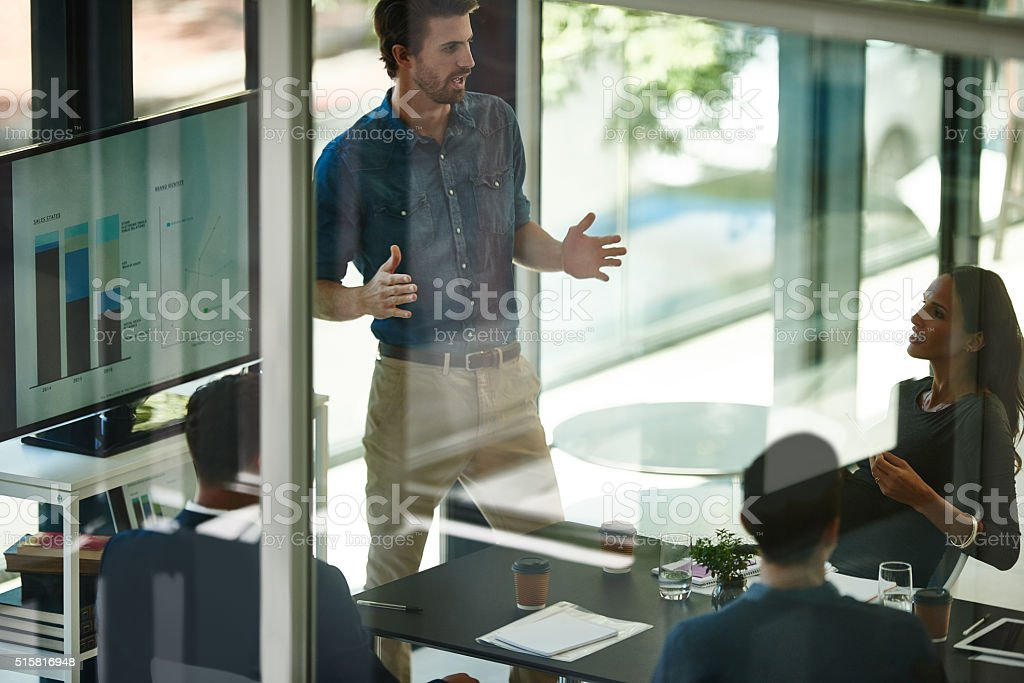 Charting their company's success stock photo