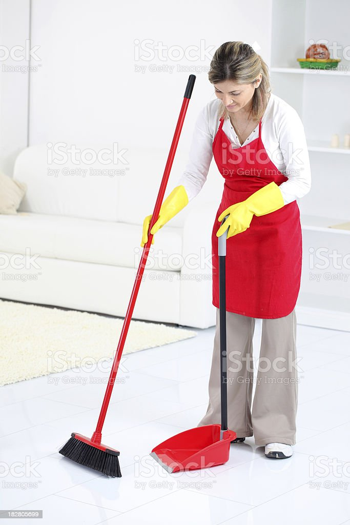 Charwoman sweeping a room. royalty-free stock photo