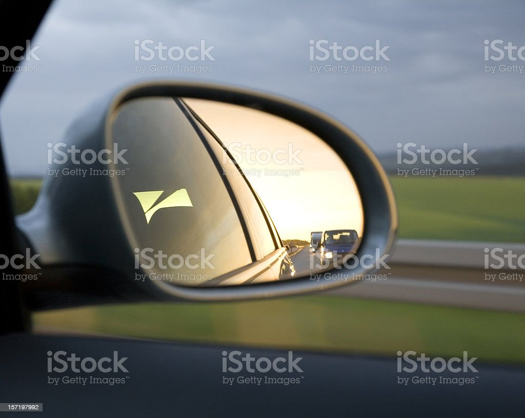chasers in the mirror royalty-free stock photo