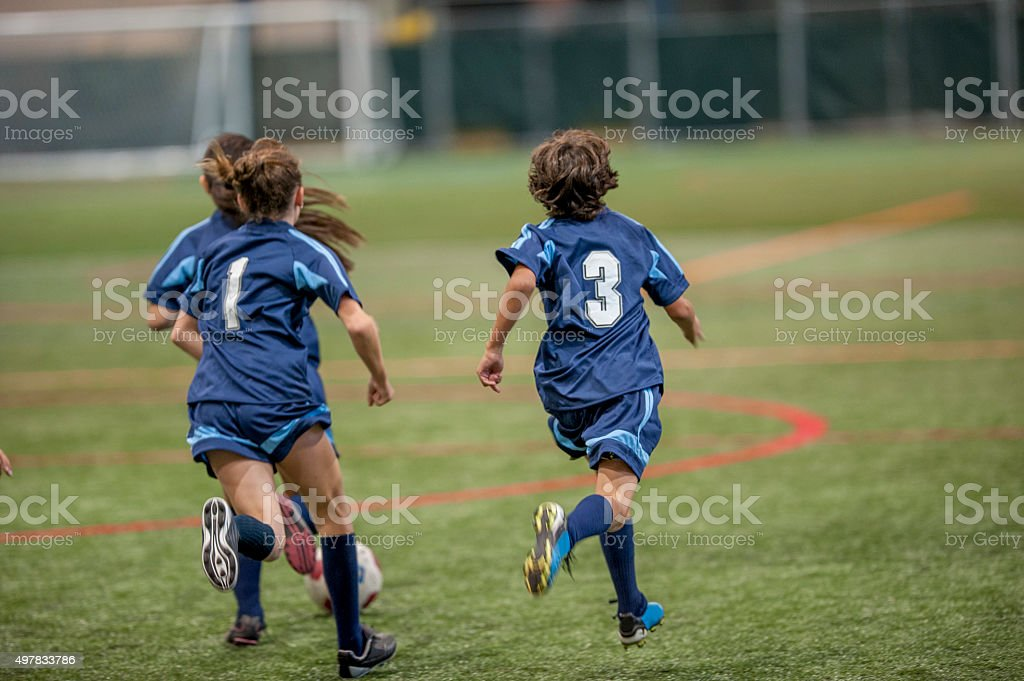 Chasing After a Soccer Ball stock photo