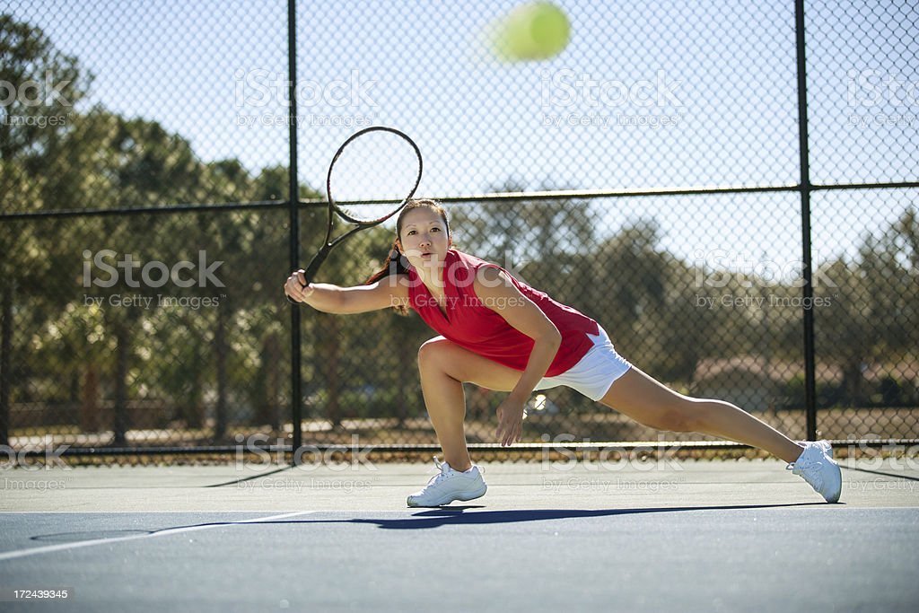 chasing down a tennis ball royalty-free stock photo