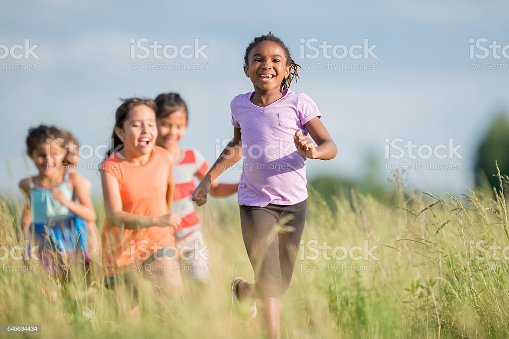 Chasing Each Other Outside stock photo