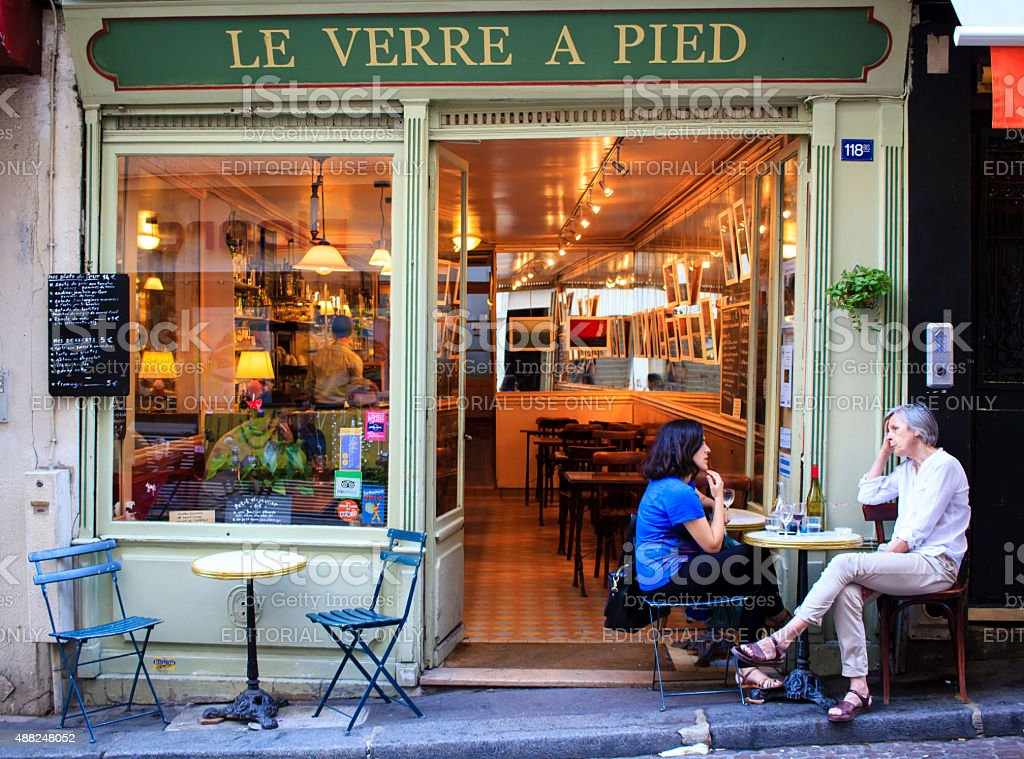 Chat in the evening cafe, Paris stock photo