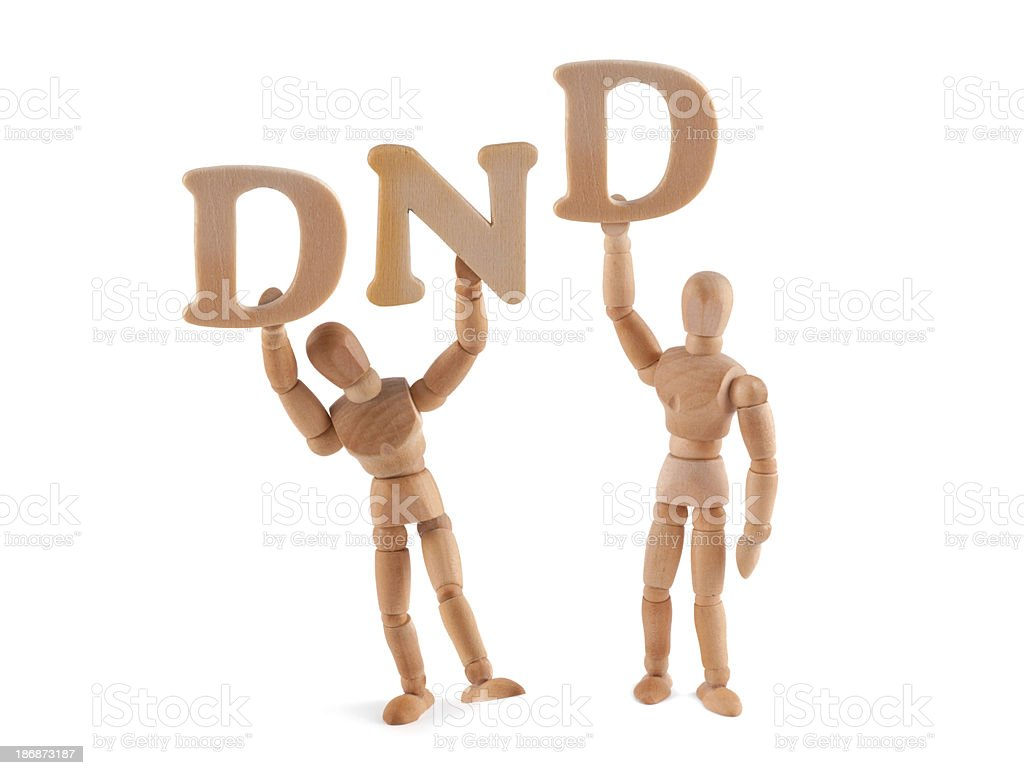 Chat Speech- Do not disturb - wooden mannequin holding letters stock photo