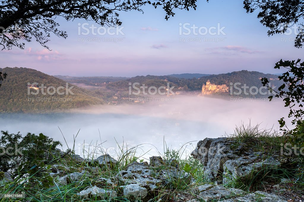 Chateau Castlenaud above the early morning mist stock photo