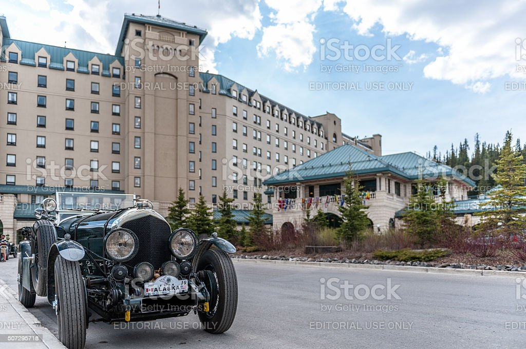 Chateau Lake Louise hotel  with antique car stock photo
