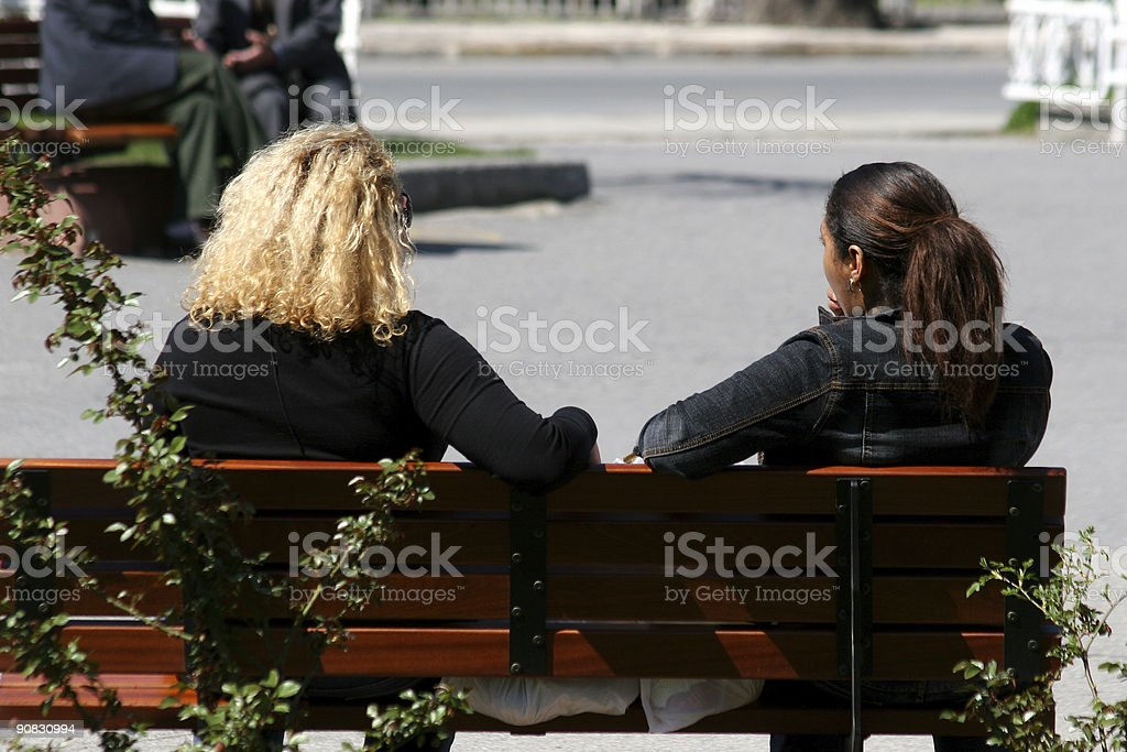 Chating in the park stock photo