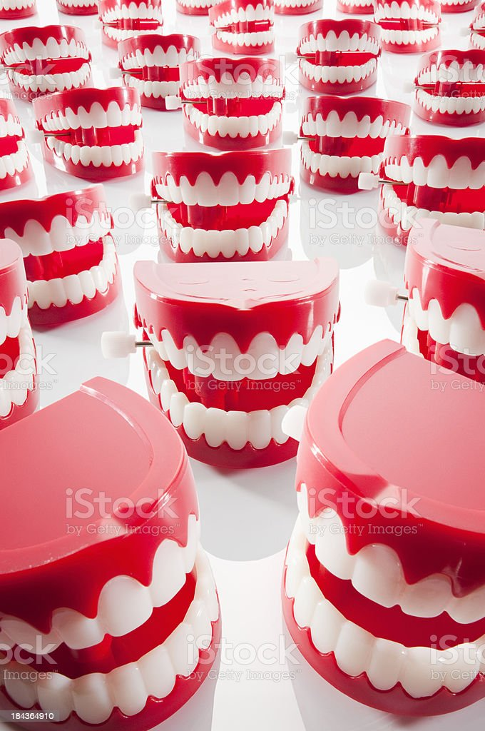 Chattering red and white plastic teeth facing camera stock photo