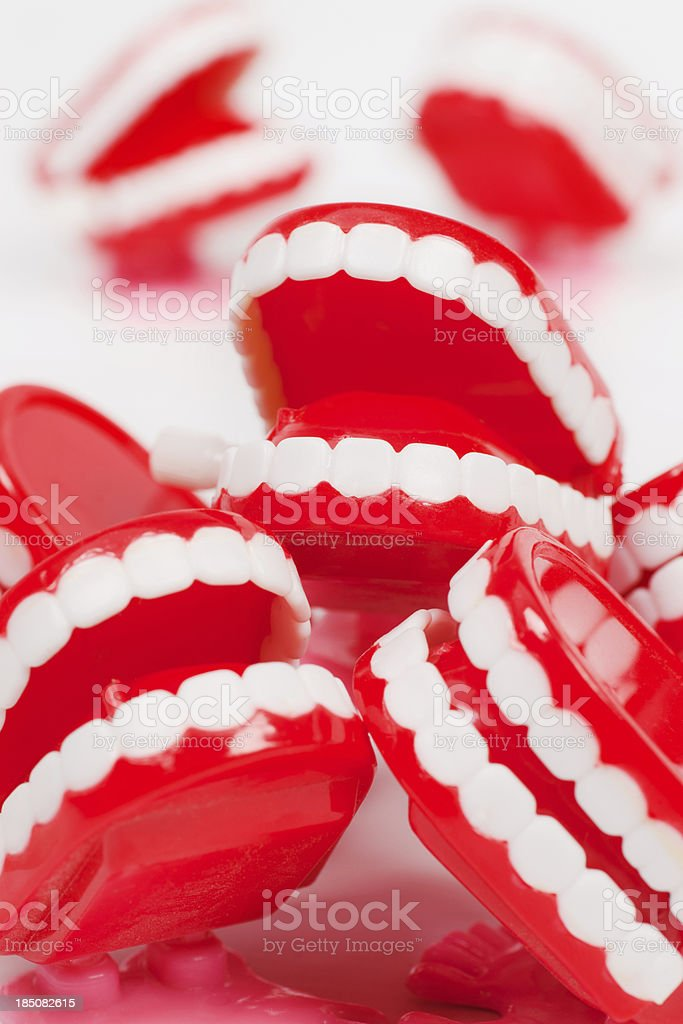 Chattering teeth shouting to be heard stock photo