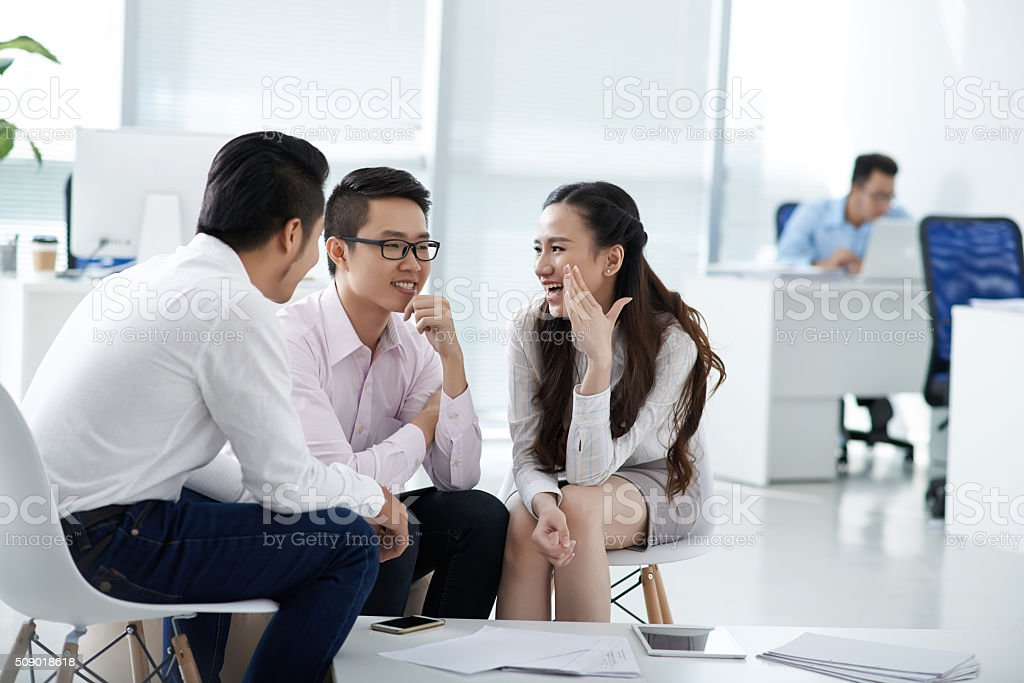Chatting colleagues stock photo