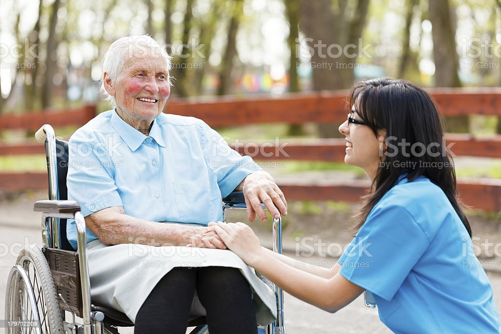 Chatting with Elderly Lady royalty-free stock photo