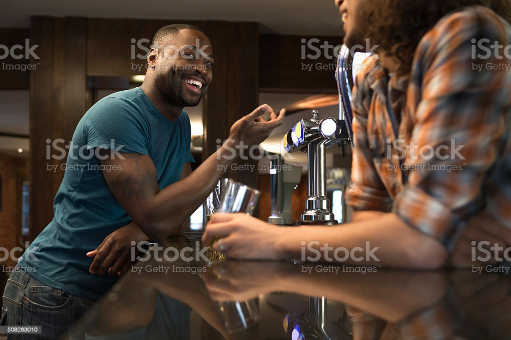 Chatting with the bartender stock photo