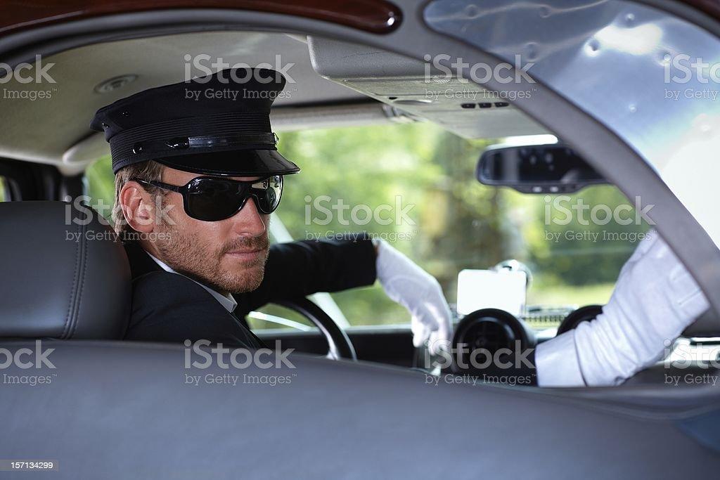 Chauffeur in elegant car stock photo
