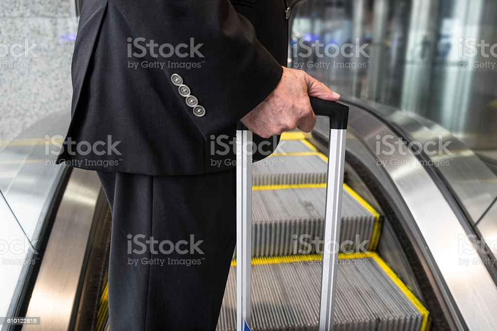 Chauffeur With Suitcase in Airport stock photo