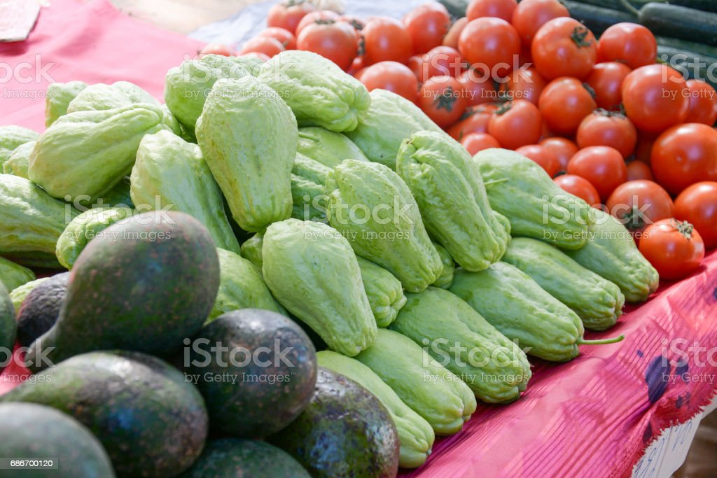 chayote fruit in the market stock photo