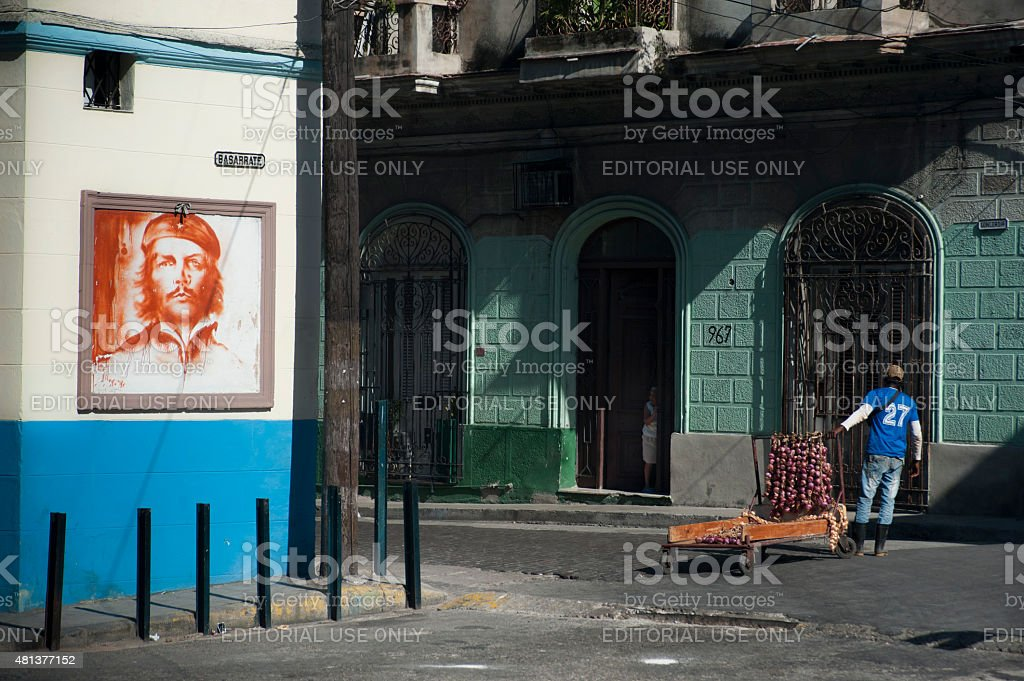 Che Guevara mural and onion seller stock photo