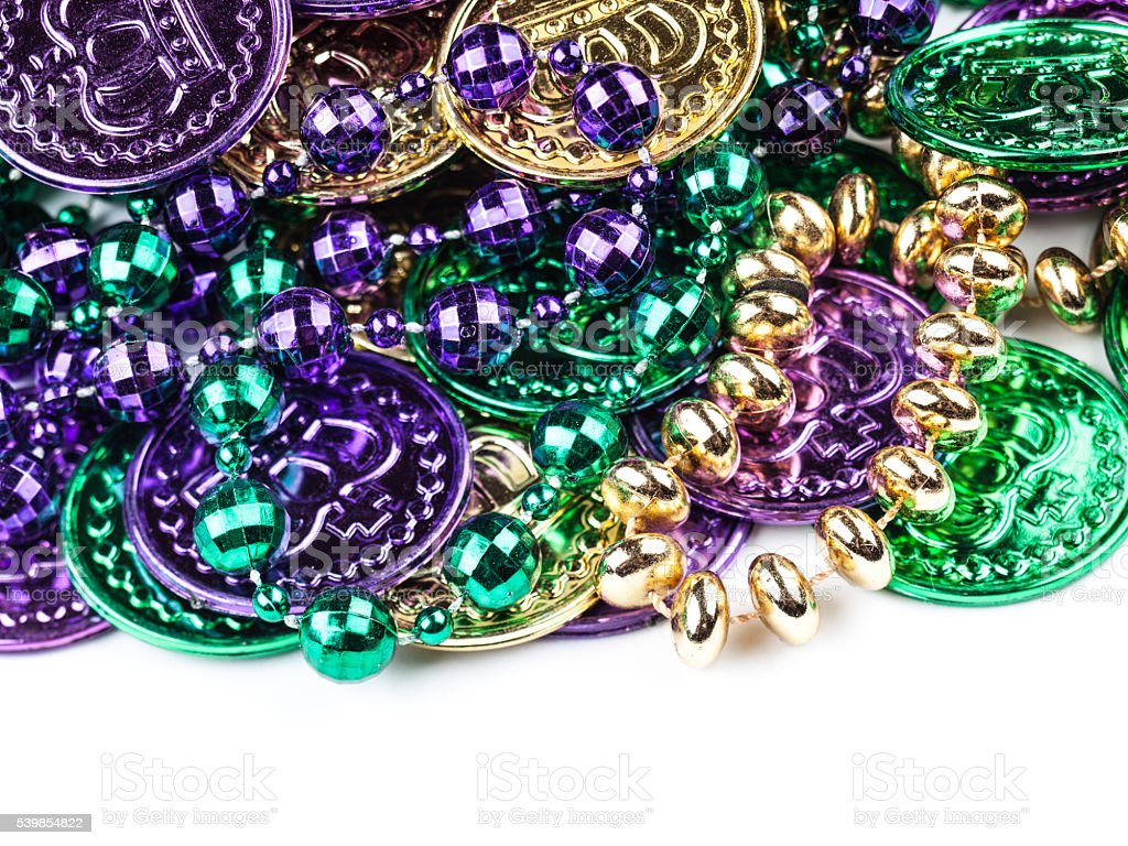 Cheap plastic Mardi Gras coins and beads stock photo