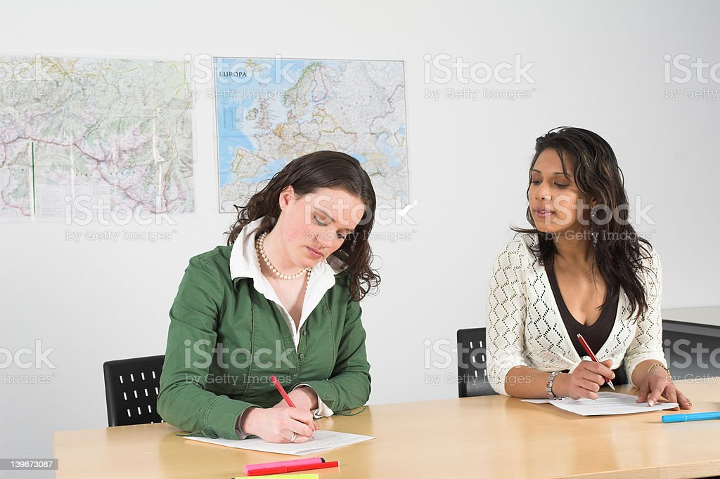 Cheating during a test stock photo