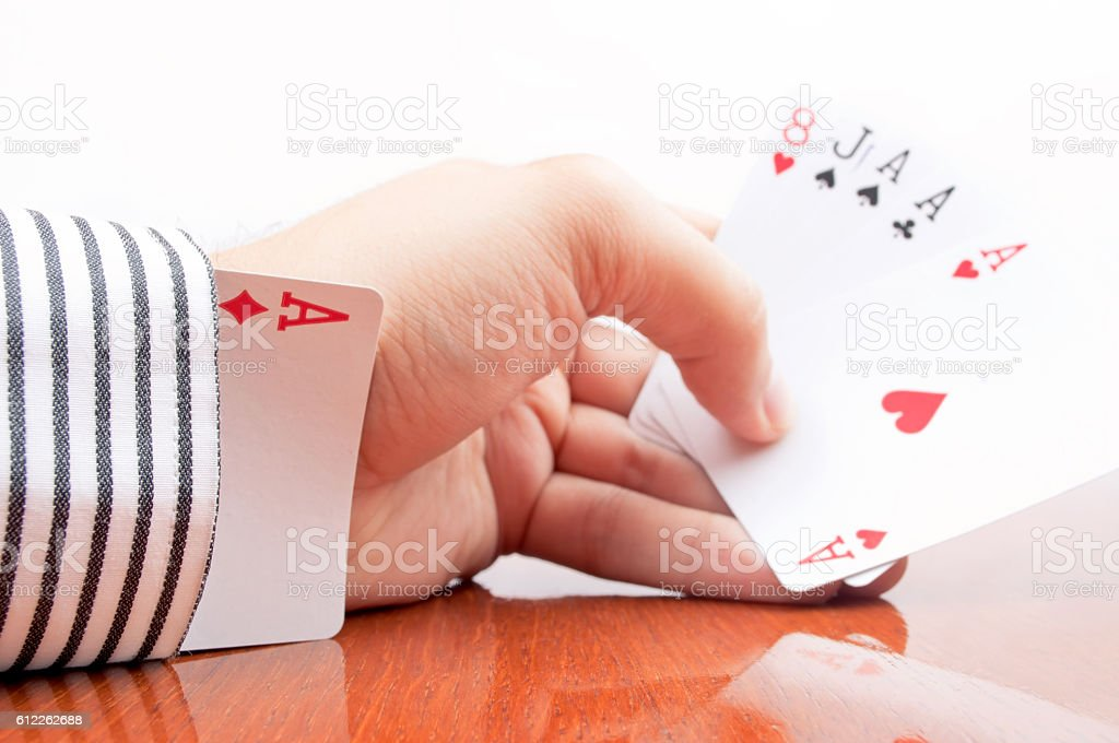 Cheating in a poker game stock photo