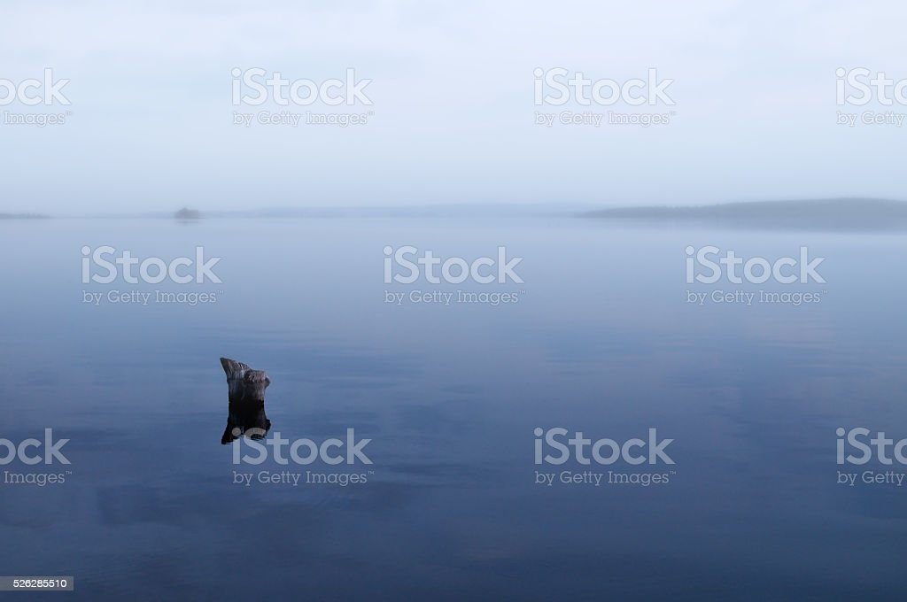 Chebarkul Lake in the fog in Southern Urals, Russia. stock photo