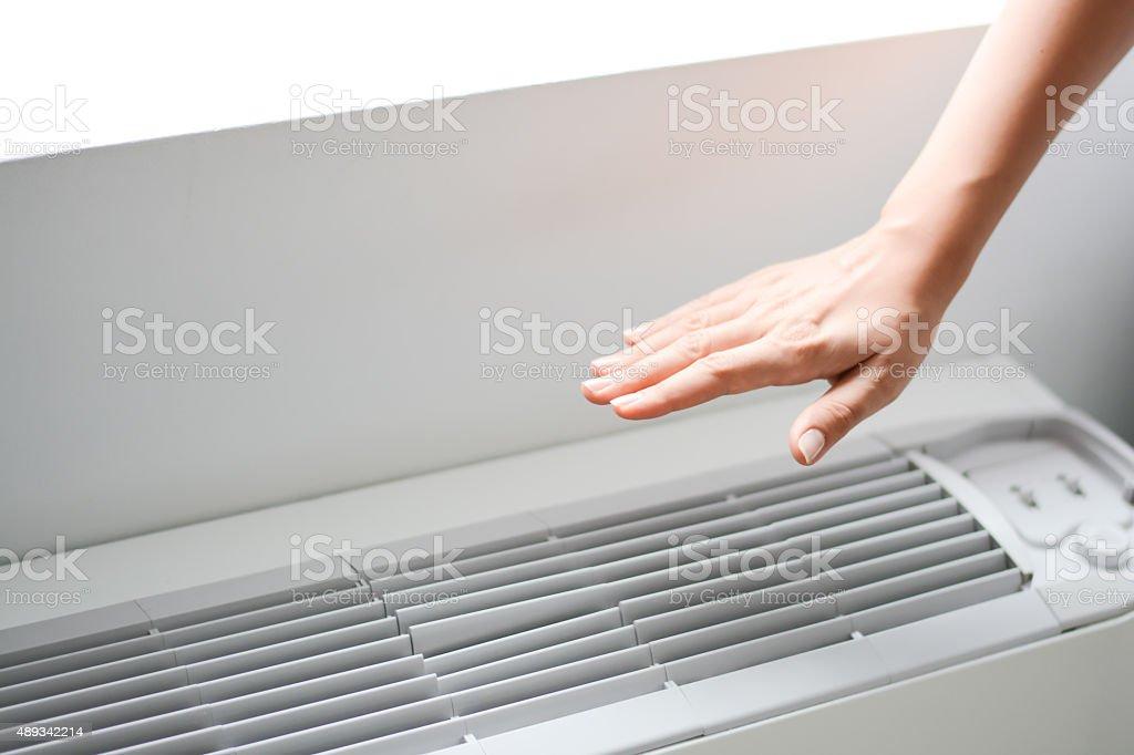 Check air conditioner heat or room temperature stock photo