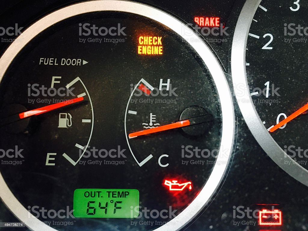 Check engine light on in car dashboard stock photo