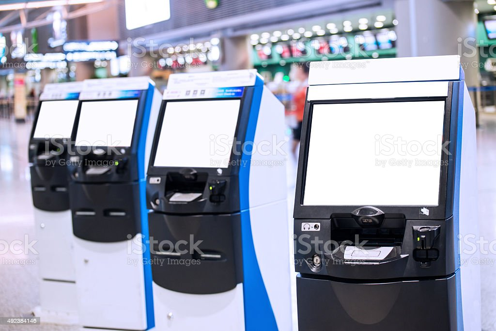 check in machine in airport stock photo