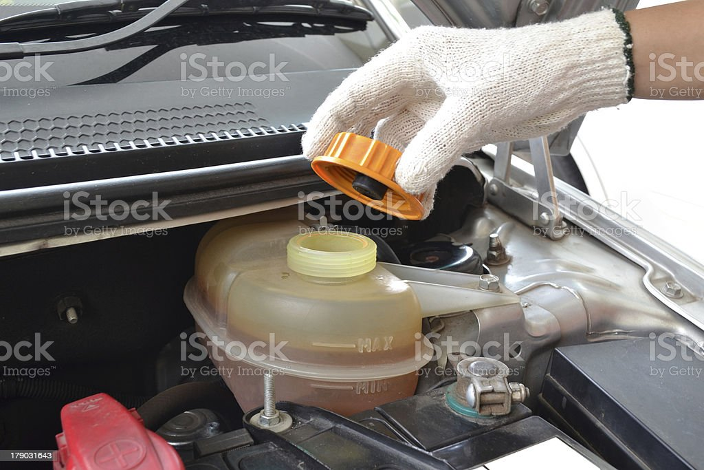 Check liquid inside a car engine. royalty-free stock photo