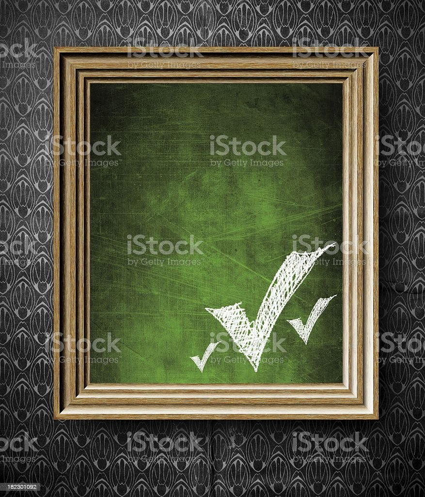 Check marks symbol with copy-space chalkboard in old wooden frame stock photo
