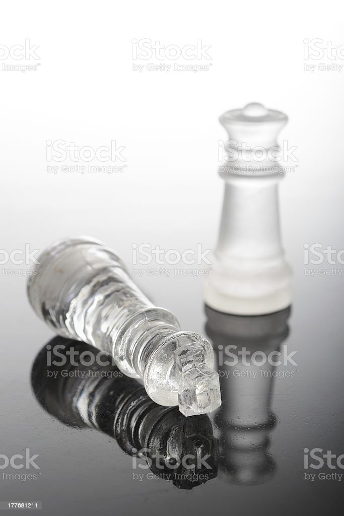 Check mate Glass chess pieces with queen over king royalty-free stock photo