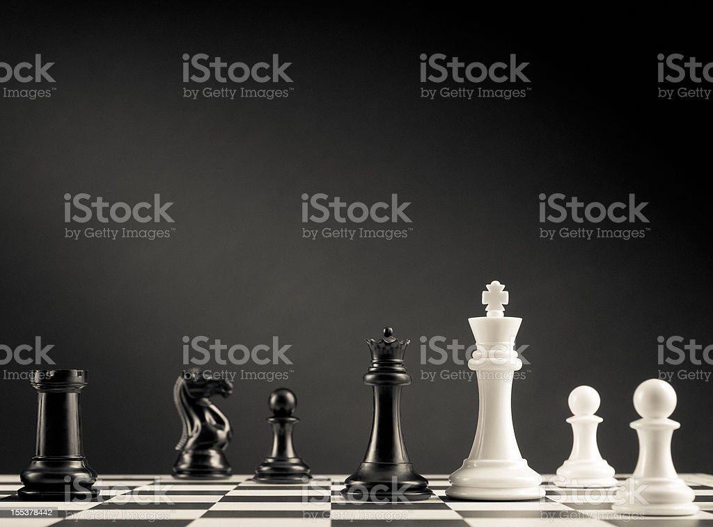 Check move, black and white chess pieces on chess board stock photo