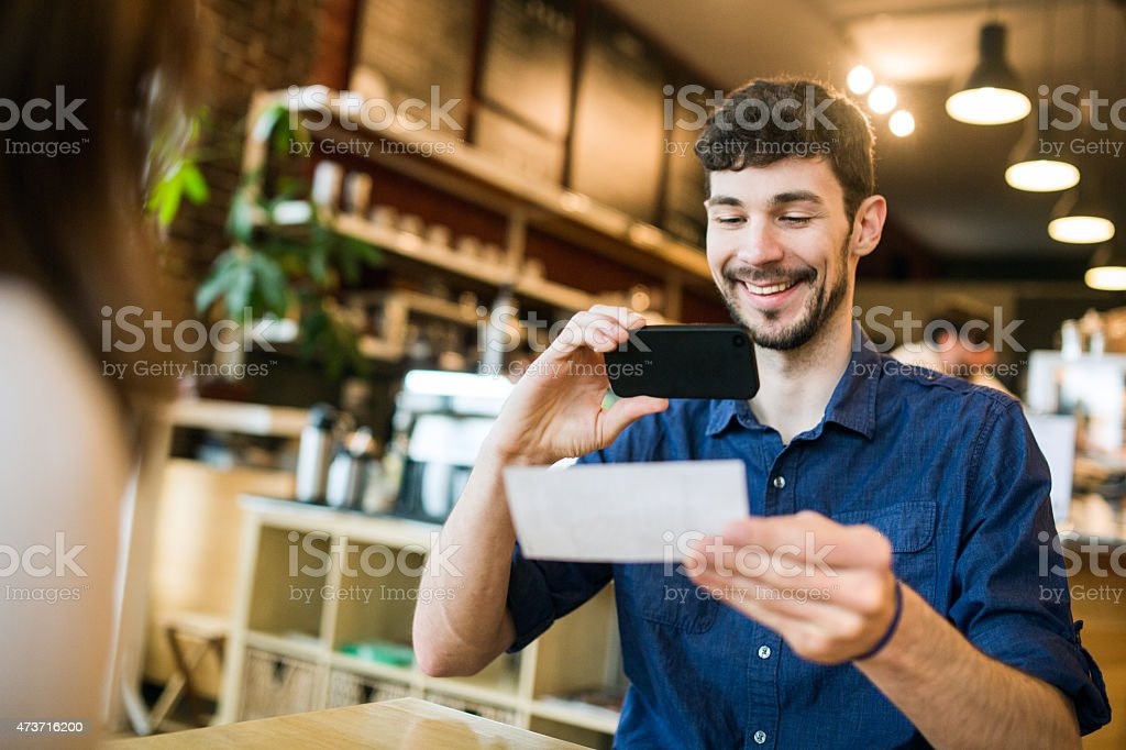 Check Remote Deposit Capture at Cafe stock photo