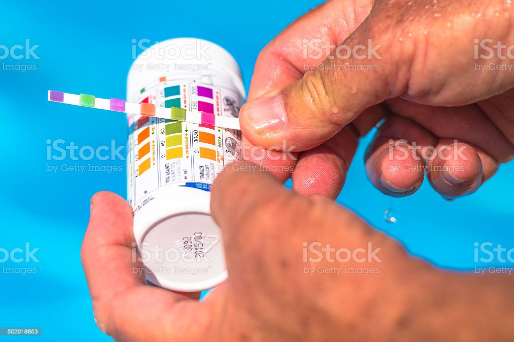 Check the pH of a private swimming pool royalty-free stock photo