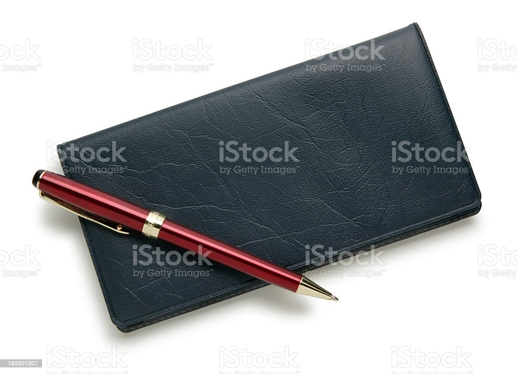 Checkbook and red pen isolated on a white background stock photo