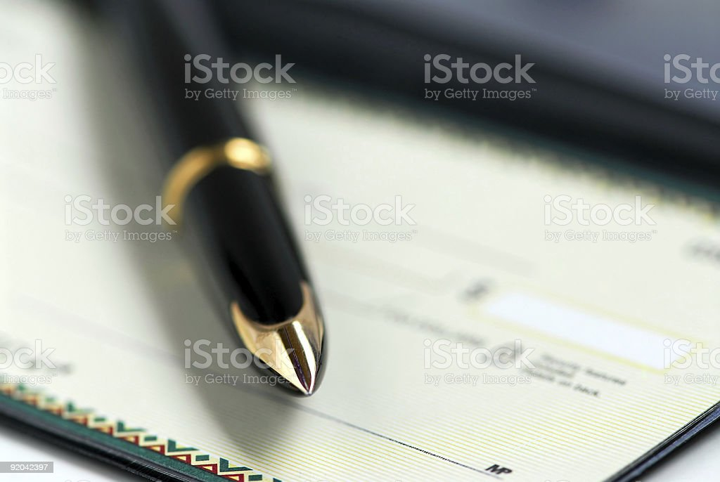 Checkbook pen royalty-free stock photo