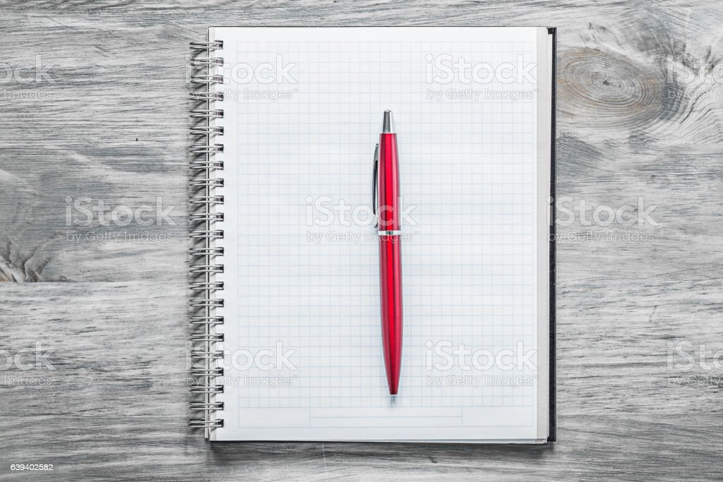 Checked blank notepad red pen on wooden board office concept stock photo