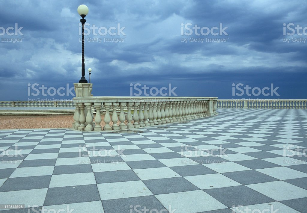 Checked Boardwalk Overlooking the Sea royalty-free stock photo