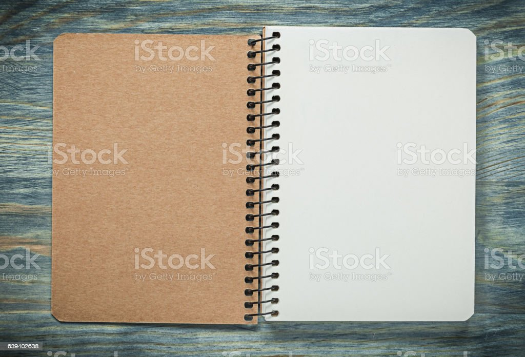 Checked copybook on wooden board office concept stock photo