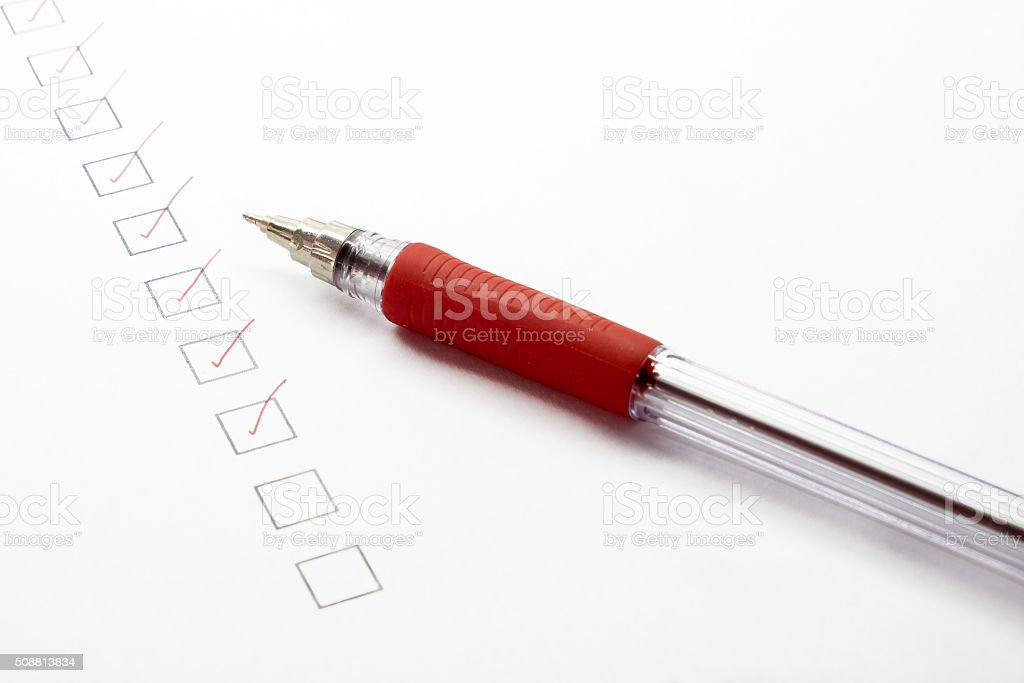 Checked list paper and red pen stock photo