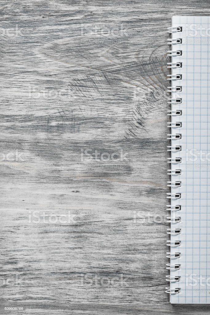 Checked note-book on wooden board copy space office concept stock photo