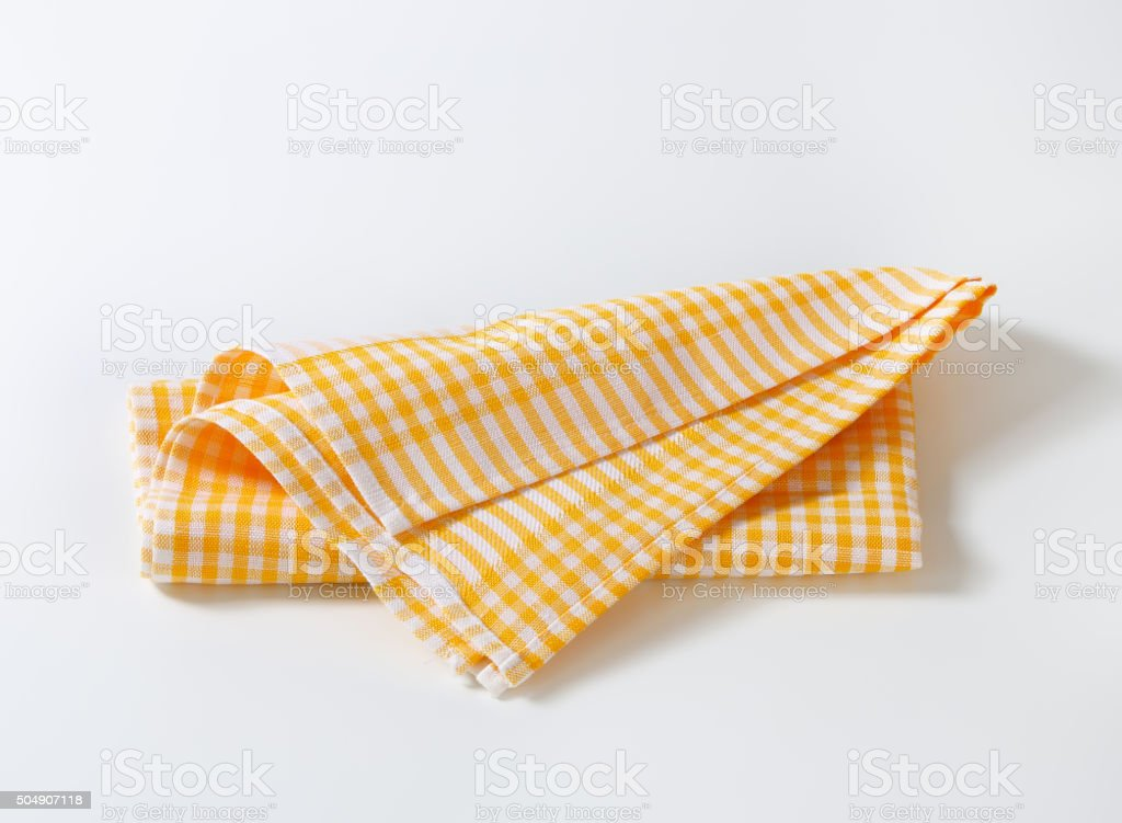 Checked tea towel stock photo