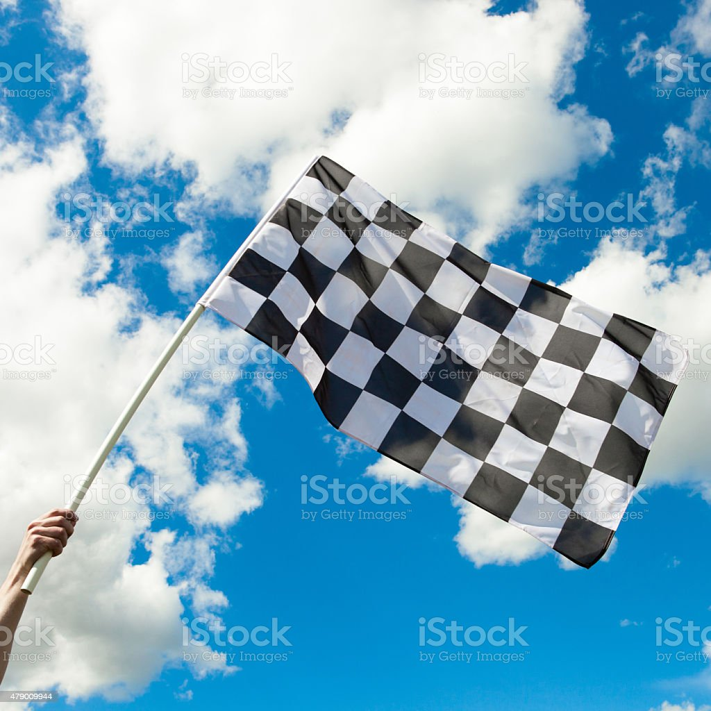 Checkered flag in the wind - close up outdoors shot stock photo