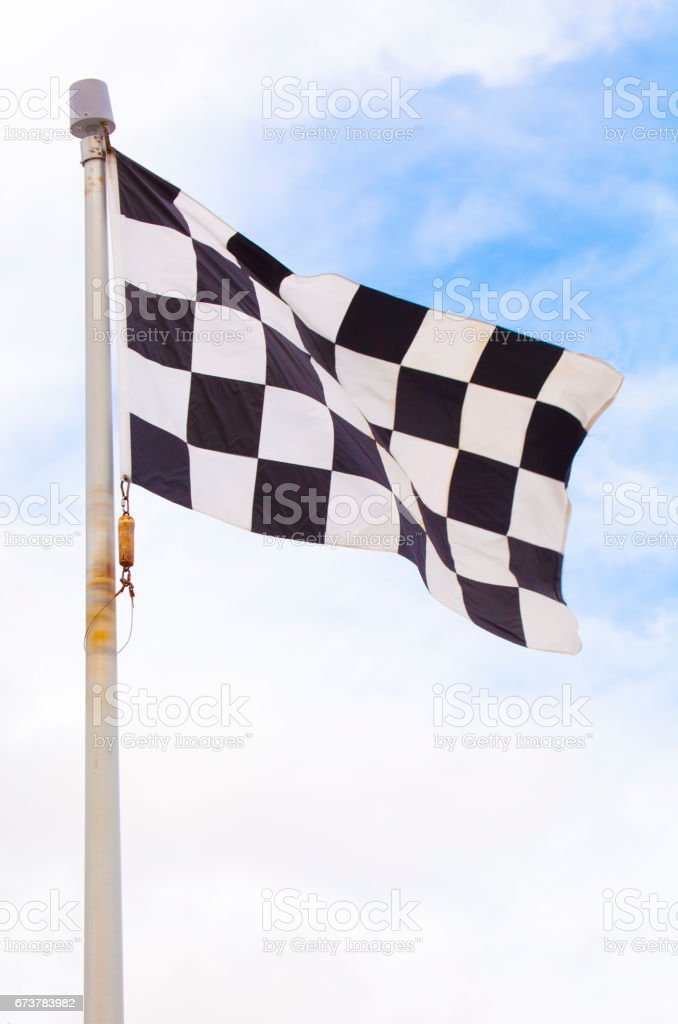 Checkered flag on flagpole stock photo