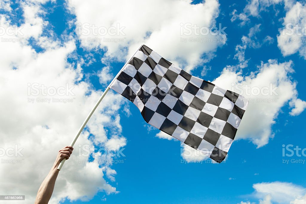 Checkered flag waving in the wind - outdoors shoot stock photo
