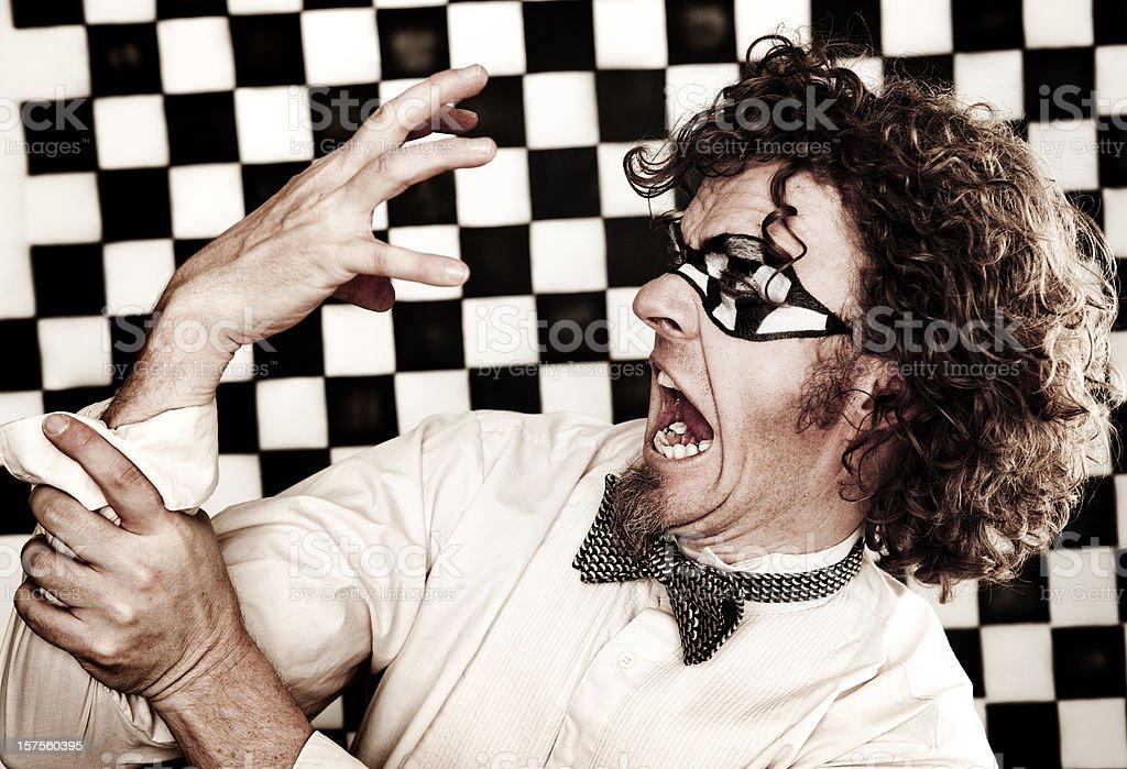 Checkered Man Series: Hand Attack royalty-free stock photo