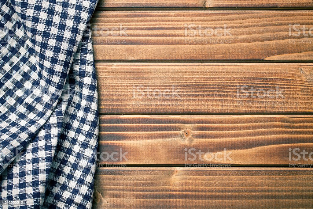 checkered napkin on wooden table stock photo