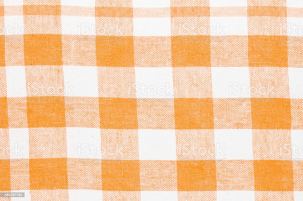 checkered orange and white kitchen towel background texture