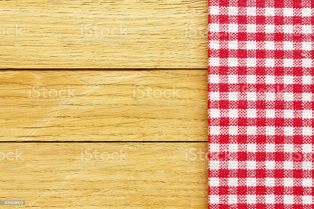 Checkered Tablecloth On The Brown Wooden Background stock photo