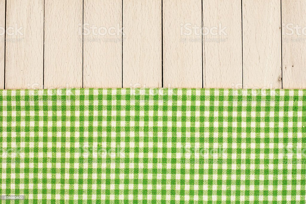 Checkered Tablecloth On The Wooden Table stock photo